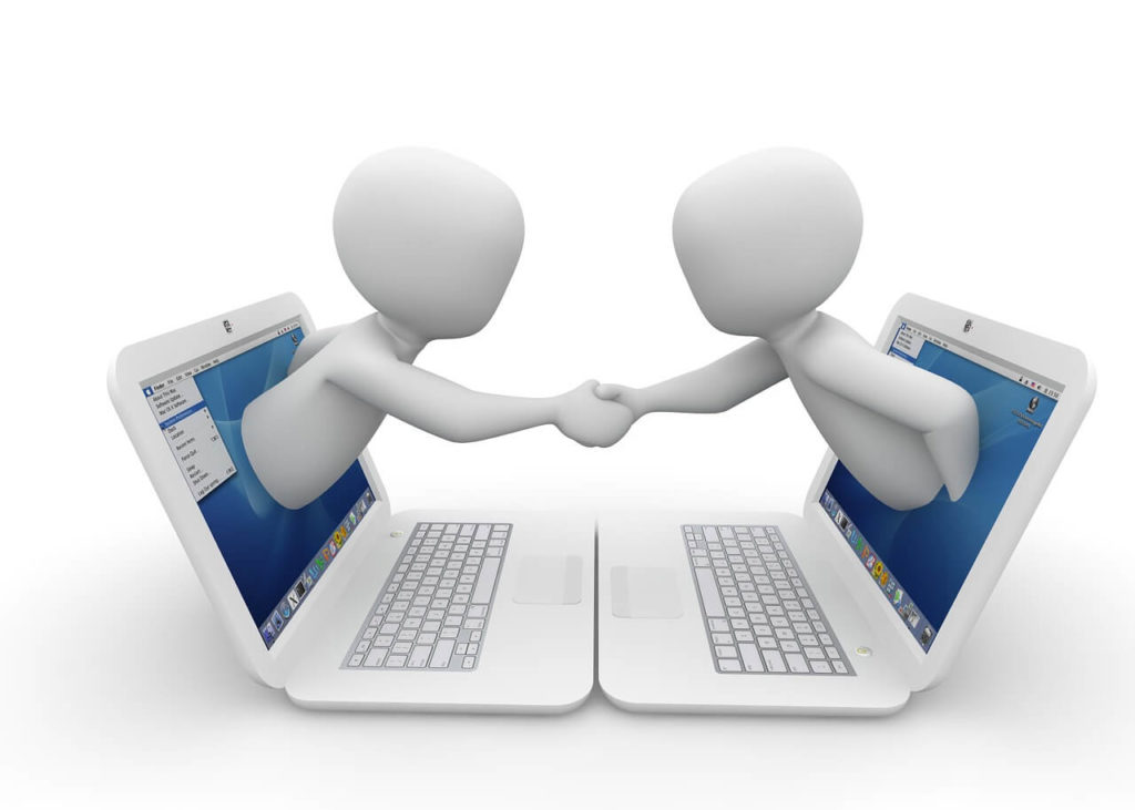 Two Laptops Shaking hands