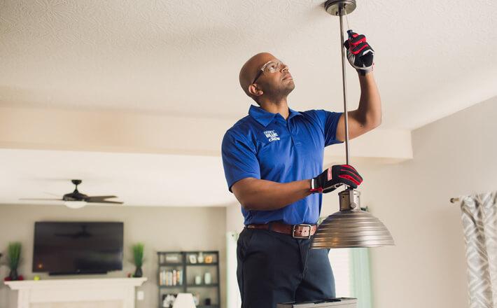 Real Estate Agent - man making home repairs